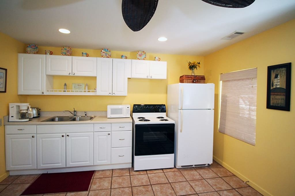 Kitchen with Range, Microwave and Refrigerator No Dishwasher
