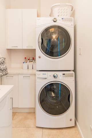 Laundry Room with brand new washer and dryer.