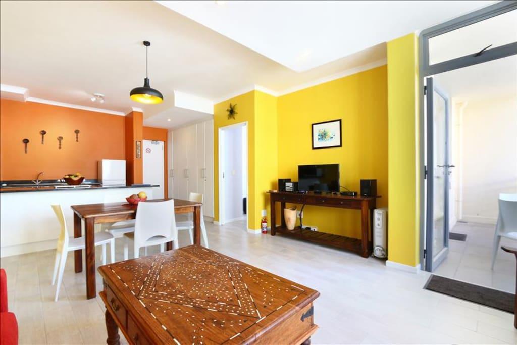 Living room to balcony and main bedroom