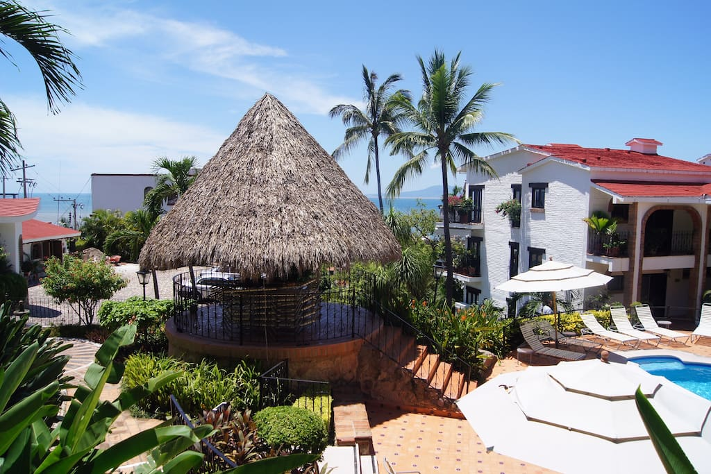 View from condo of pool area palapa and Pacific Ocean