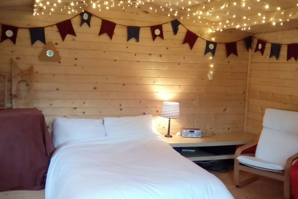 Double bed with fairy lights
