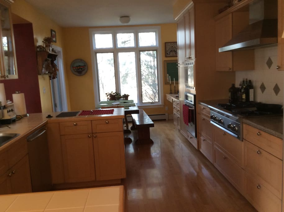 Kitchen is fully stocked with industrial gas stove, oven, dishwasher and microwave