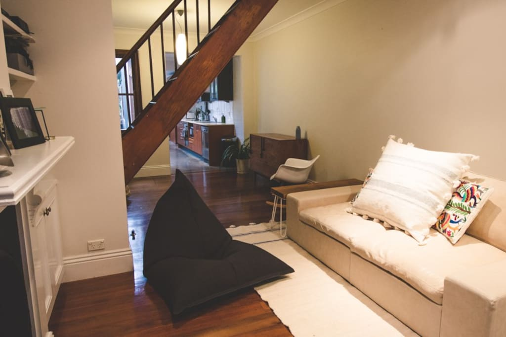 Living area with oversized designer leather sofa and comfy beanbag chair