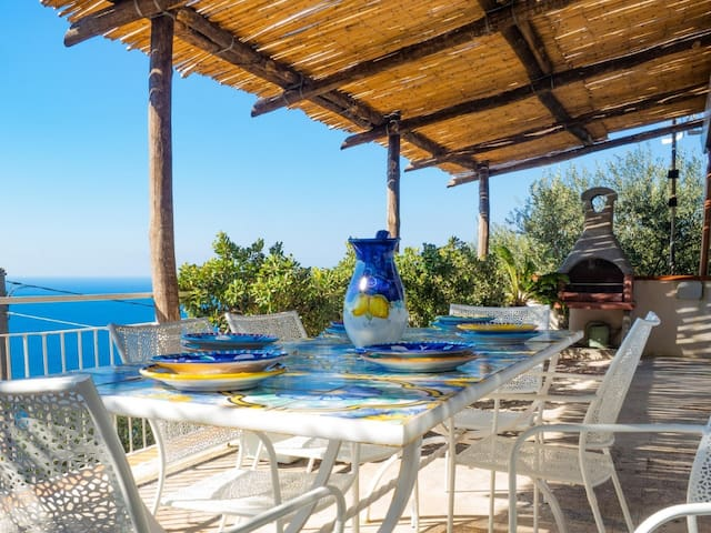 External terrace fully equipped with table and chairs. Amazing sea view on Capri Island