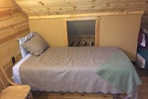 Twin bed #3 with luggage cabby in the loft
