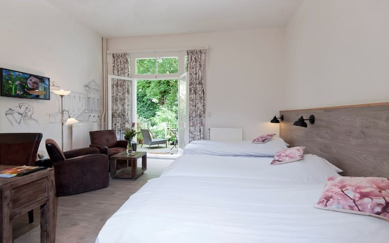 Quad room (4 persons)with private bathroom and toilet