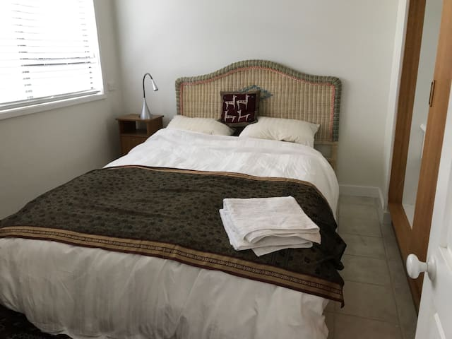 Queen size bed with 2 electric blankets, large wardrobe and full-length closet to hang dresses and coats. Fan and mozzie repellant to keep mosquitoes away.