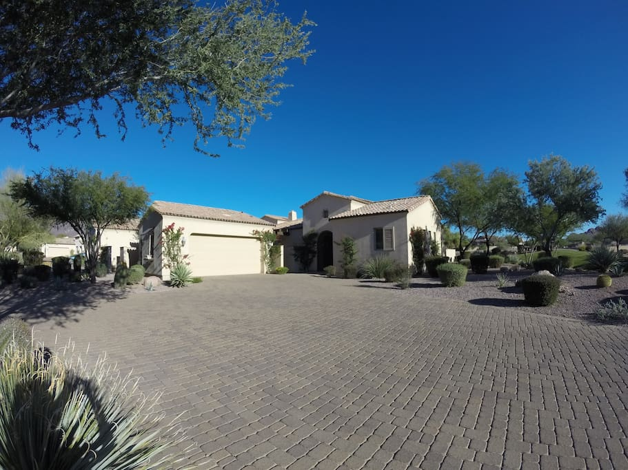Front of house. On the right guest casita with a detached 2 car garage on the left.