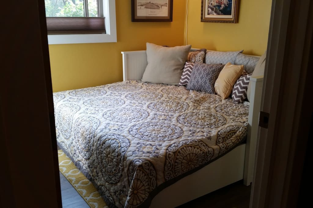 Day bed pulls out to a king size and can push back during the day for more room.