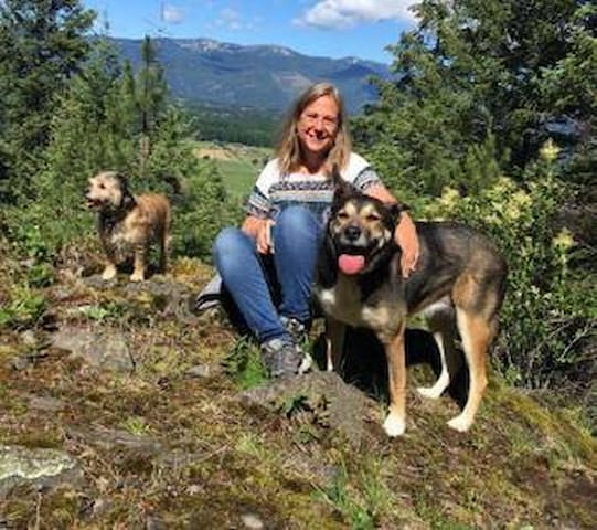 Alison, owner and artist in residence with resident furries; Lotus Blossom (right) and Little Bear (left) in front of a view from our property. We also have 2 cats in the yard, Aria and Louie.