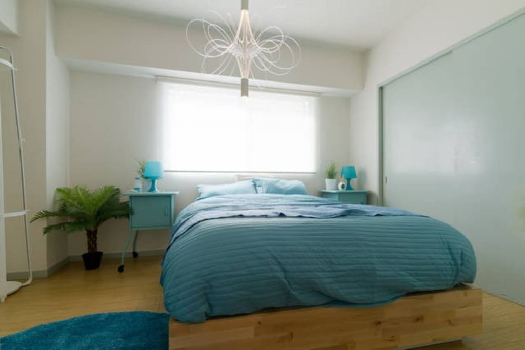 Master bed room with a comfortable bed