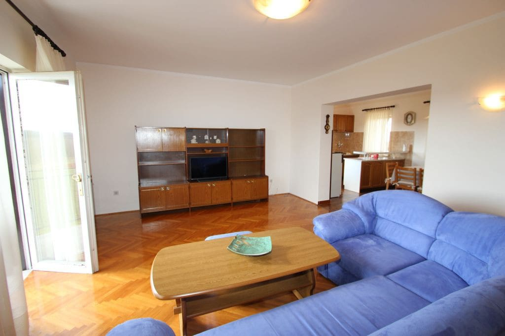 Spacious open living room with dinning area and kitchen.