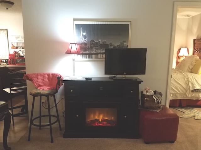 This extra cozy fireplace provides comfort,  heat, and/or a great relaxing display!