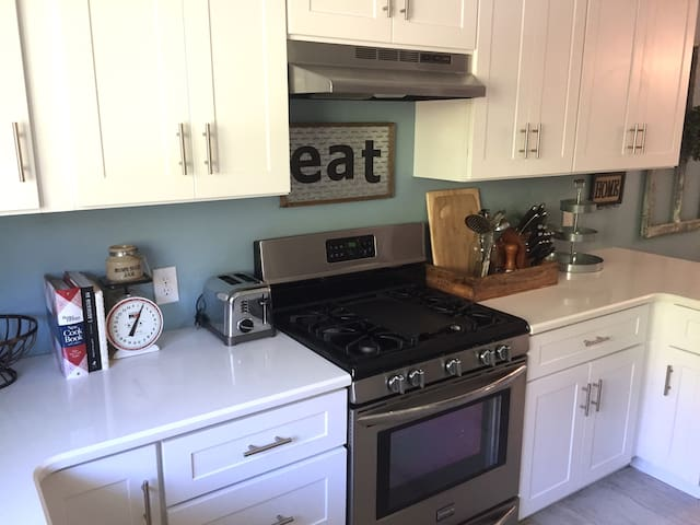 Completely remodeled and updated kitchen features a gas stove.
