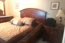 Private bedroom with tv, extra towels and linens, deadbolt locking door.