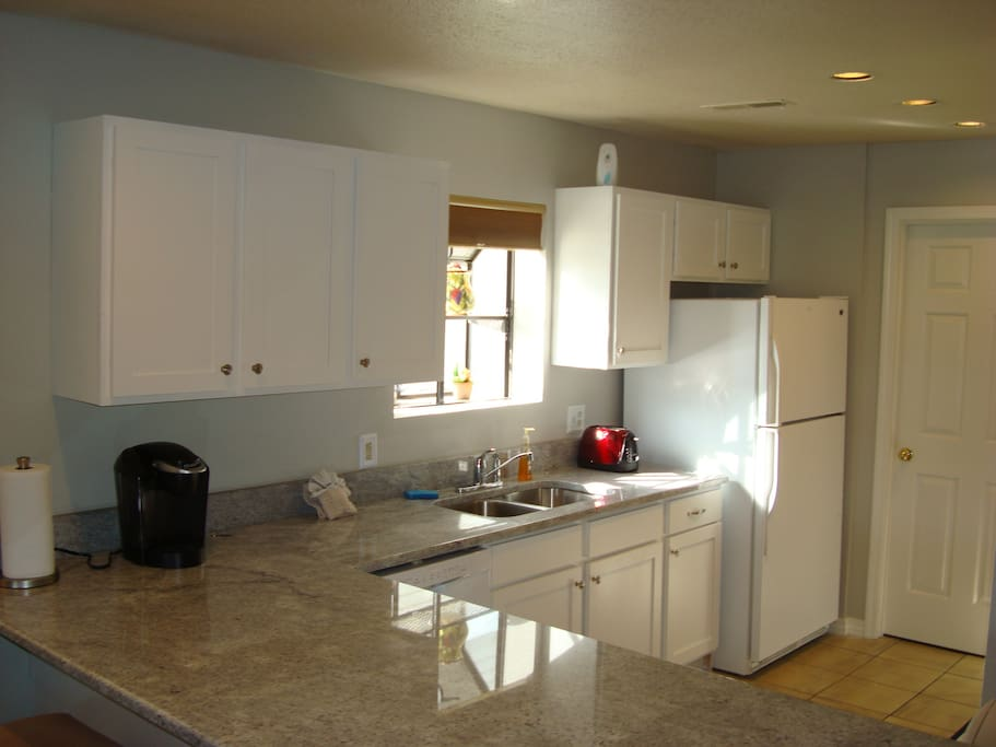 Full size kitchen features Keurig, along with 12 cup brew.  Coffee, tea, and sweeteners supplied.