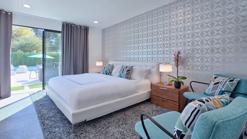 Master bedroom #1- King size bed overlooking the pool area, direct access to the spa. Glass beaded wallpaper makes the room sparkle!
