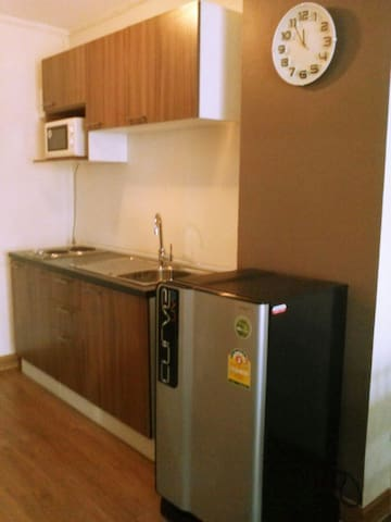 New Kitchen with electric stove and microwave