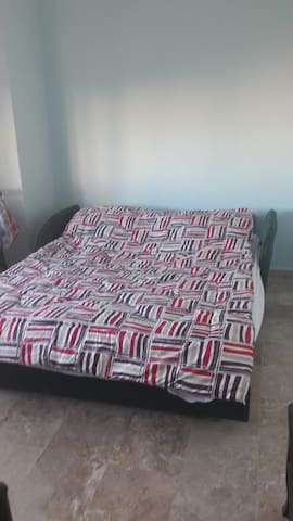 bedroom with king size bed and other 2 single bed