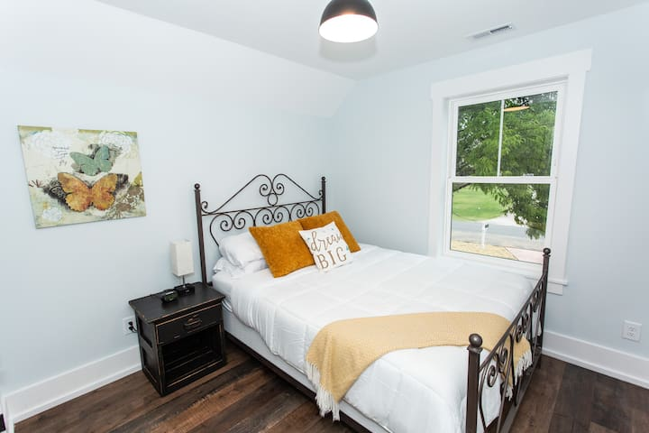 Master bedroom with a super comfy bed and luxe linen