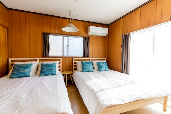 A little bed side table gives you a space to put on the belongings.  There will be a air-conditioning is provided in this bed room.
