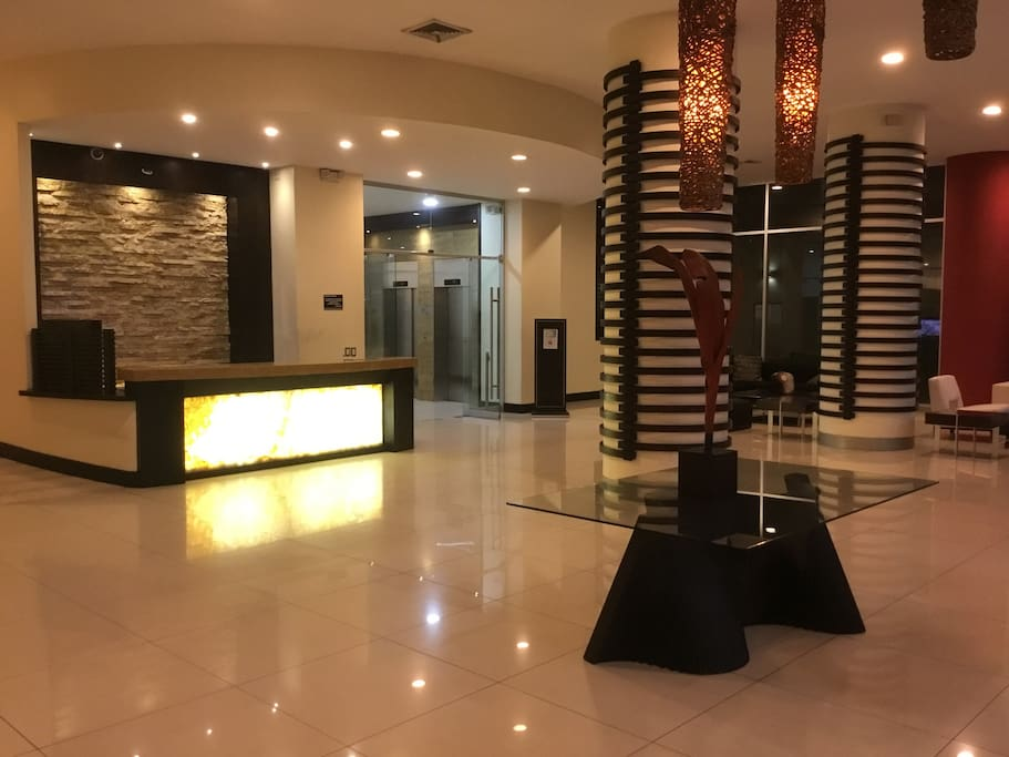 Grand Lobby with Wi-Fi and lounge seating - 24 hours service