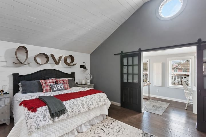 Master bedroom (during December) with a peek at large office and large walk in closet. Walk in closet is large enough for port a crib. Double barn doors close for privacy from master. Large Love sac is big enough for an 8th to sleep on (child).