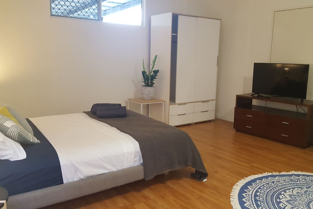 Sleeping area with TV and wardrobe
