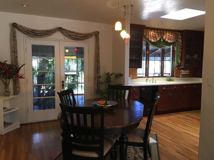 Dinning room and kitchen. Door leads to lovely backyard.
