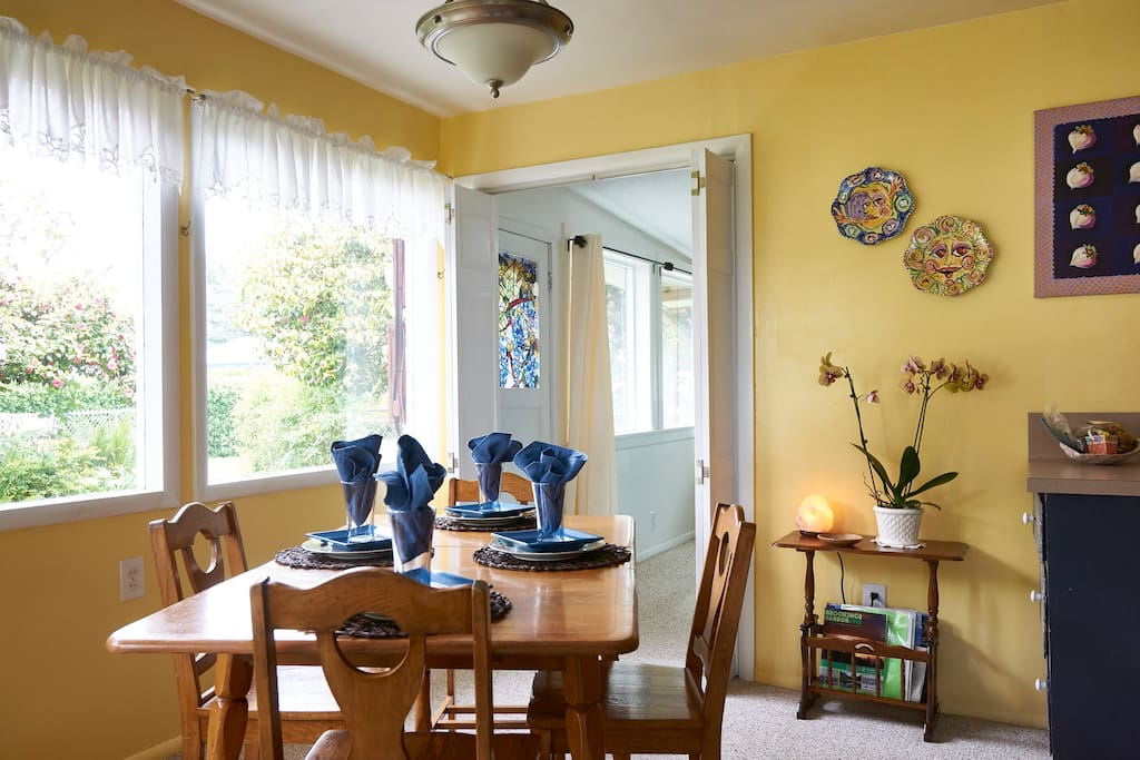 Dining room with views of the garden and a peek of the ocean.