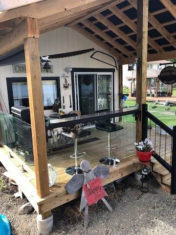 Deck for cabin with granite food bar propane barbecue
