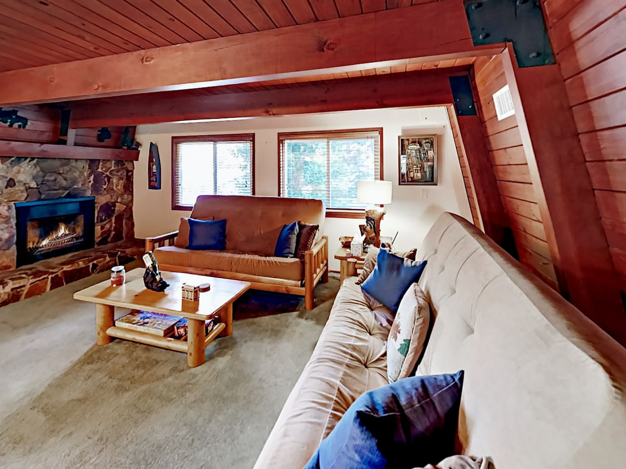 Welcome to Big Bear City! With 2 large sofas and a striking stone fireplace, the living room serves as the social heart of this home.