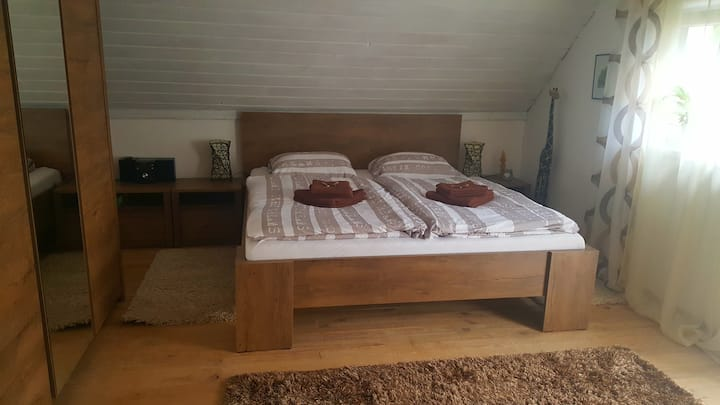A bedroom in a shared house by lake Teplý Vrch