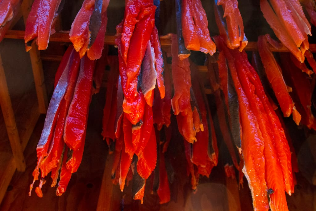 Salmon strips hanging in the smoke house