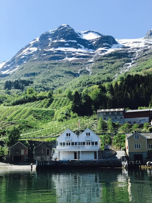 You will be renting the house to the left. Seen from the fjord.