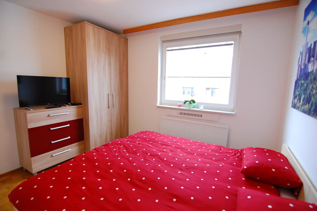 cosy bedroom with wardrobe and TV