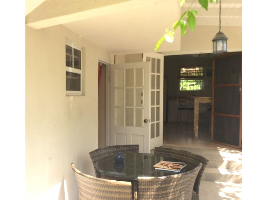 Private sunny gated patio with double doors leading to the kitchen and single door leading to the lounge