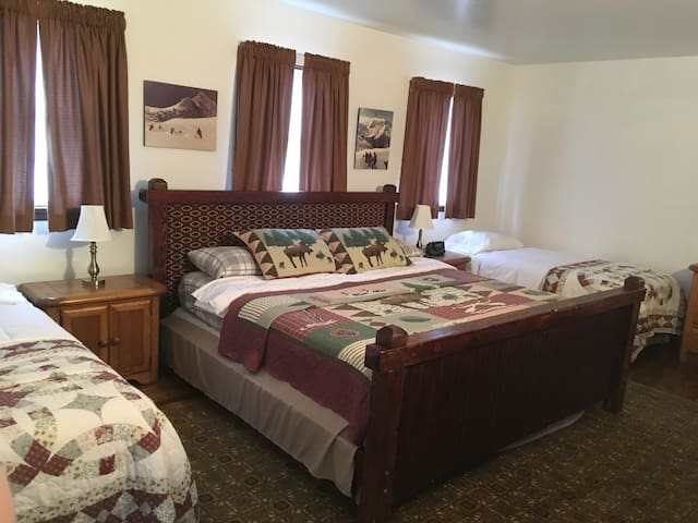Bedroom 1 - Master with half bath.  King Bed with two Twins.