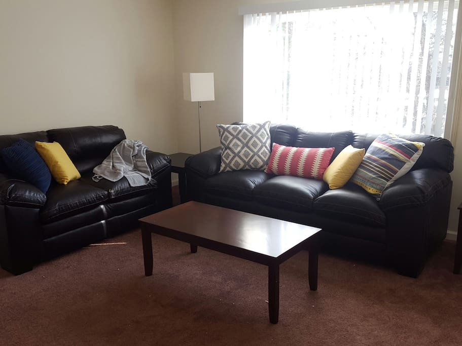 The overstuffed faux leather sofa and love-seat provide ample seating - and napping - space!