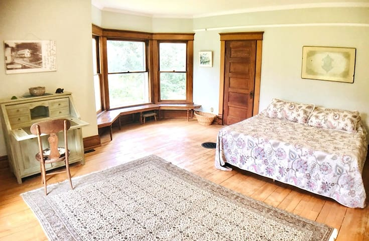 Room one  features:  ~ king-sized bed ~ writing desk ~ private bath ~ gorgeous views of the river and fields from 2 windows ~ chest of drawers ~ 2 closets
