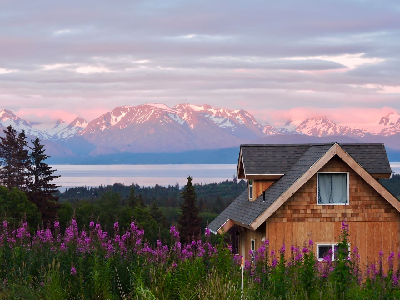 """The Smokey Bay Cabin looks out on the Kachemak Bay, which used to be called """"Smokey Bay"""".  The Grewingk Glacier is seen at the far left."""