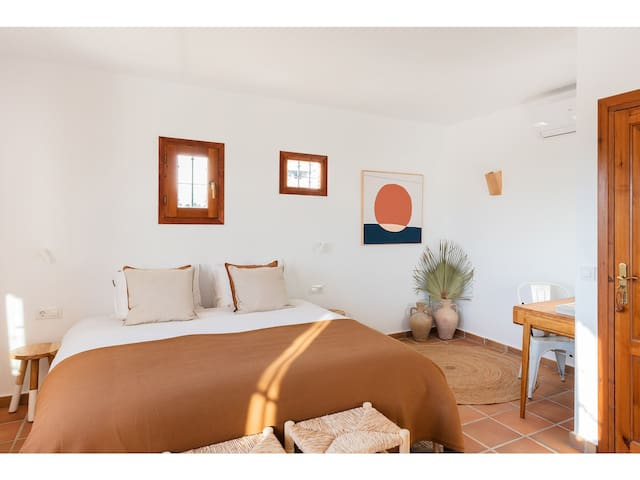 One of our two lovely rooms in the finca located on the first floor. A stylish Mediterranean en-suite bathroom and panoramic views of the luscious garden, the pool and the hills of Benissa.