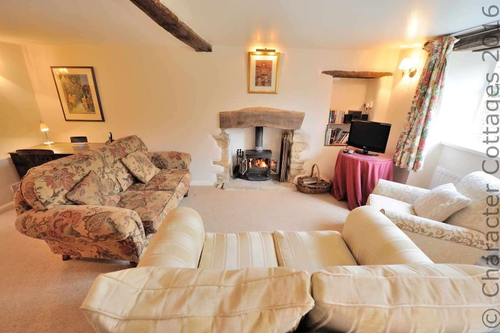 Comfy, inviting living room, with cosy log burner