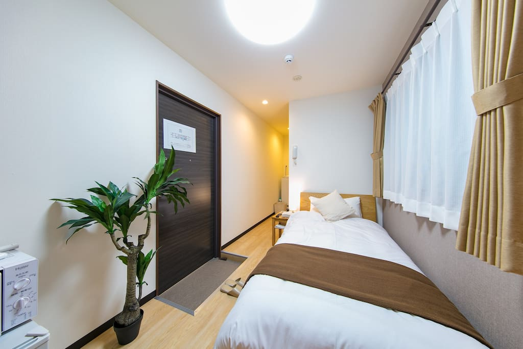 A stunning room with a bed and a kitchen. Bright in daytime and have a warm, harmonious atmosphere in nights. Best place to stay and get out of tiredness!
