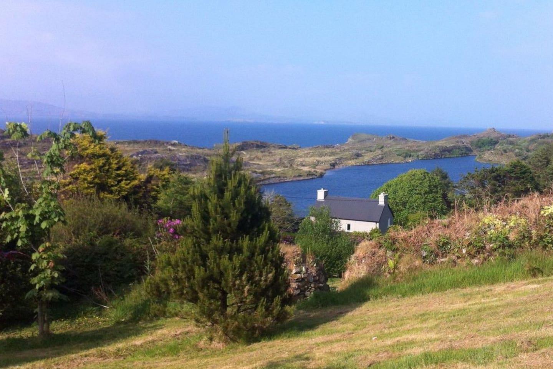 View of house, lake and sea beyond
