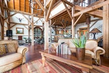 Honoring Nolan K. Harper, this amazing barn sleeps up to 8.  Wake up to morning coffee and watch the deer quietly pass by from the patio where you enjoyed wine fireside last night. Private, gated hill country ranch just 8 minutes from Main Street.