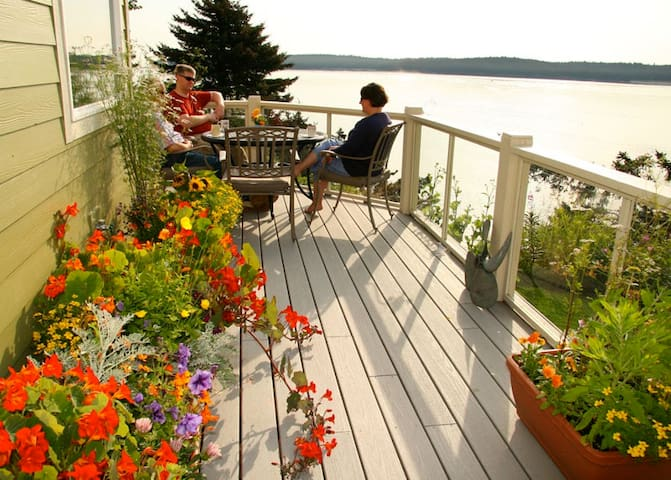 Guests enjoy coffee on the front deck