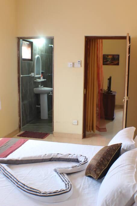 View of bedroom entrance door and the en-suite bathroom
