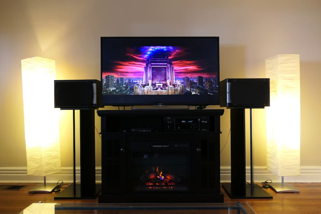 """Living room. 55"""" HDTV and stereo."""