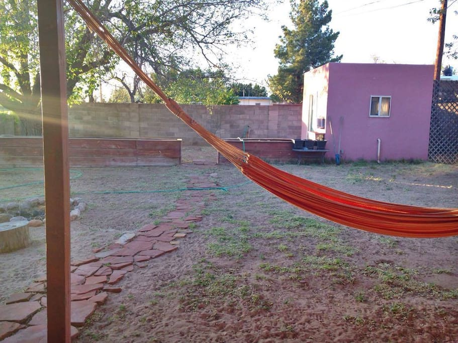 Backyard hammock and garden beds in the back. Help yourself to fresh herbs and veggies.